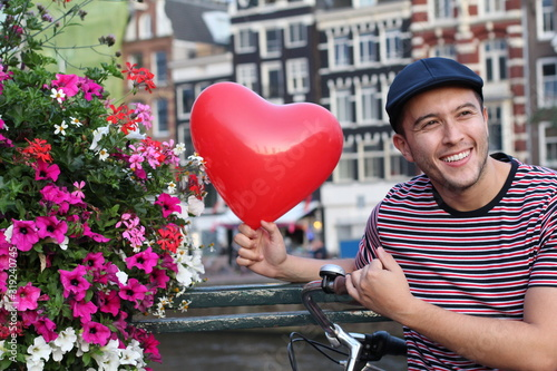 Tourist in love with Amsterdam Wallpaper Mural