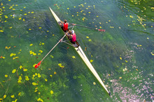 Two Young Athletes Rowing Team On Green Lake