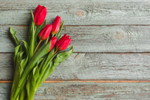 Red Tulips On Wooden Backgroun...
