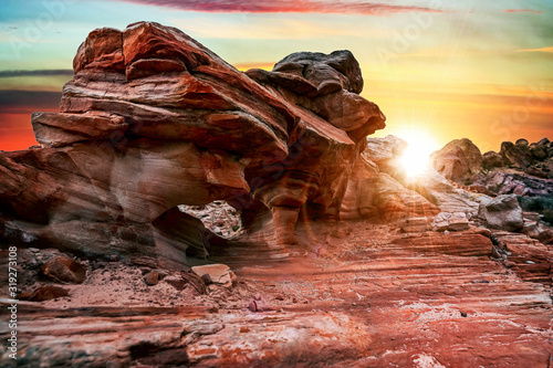 Fototapeta The mesmerizing red rock layers and formations of the desert landscape at the Valley of Fire State Park near Las Vegas, Nevada USA
