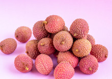 Tropical Lychee Fruit On A Pink Background.Selective Focus.