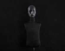 Black Mannequin Head Isolated On Black Background