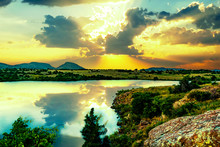 A Bright Golden Sunset In The Valley Of Wichita Mountains Wildlife Refuge Overlooking Lake Jed Johnson Near Lawton, Oklahoma, USA.