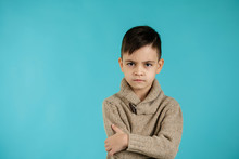 Offended Sad Little Child Boy On Blue Background. Human Emotions And Facial Expression