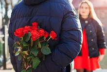 Valentines Day Roses. Man Hidi...