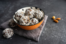 Energy Raw Walnut Balls In An Orange Bowl