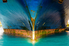View Of Very Large Container Ship Bow Part. Metal Is Damaged And Rusty.