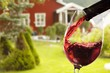 Leinwanddruck Bild Red wine and glass on outdoor background