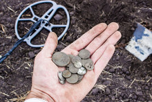 Ancient Coins Of The Russian Empire Found During Archaeological Excavations, Using A Metal Detector, The Front And Back Background Is Blurred With The Bokeh Effect