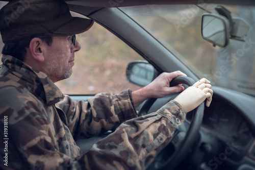 army veteran with artificial limb driving a vehicle Canvas Print