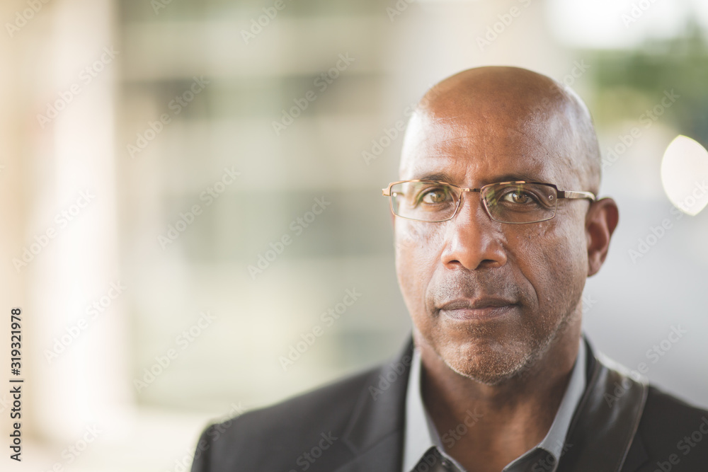 Fototapeta Portrait of a mature African American businessman on his way to work.
