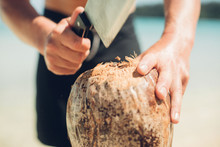 Man Cuts Open Coconut On The B...