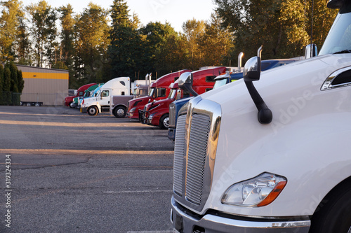 Truck stop. A row of trucks during a stopover, travel breaks. Tableau sur Toile