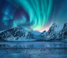 Aurora Borealis Over The Snowy...