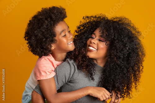 Foto Portrait of young African American mother with toddler son