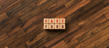 Cubes With Message FAST FOOD On Wooden Background