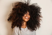Beauty Portrait Of African American Woman With Afro Hairstyle And Glamour Makeup. Brazilian Woman. Mixed Race. Curly Hair. Hair Style. White Background.