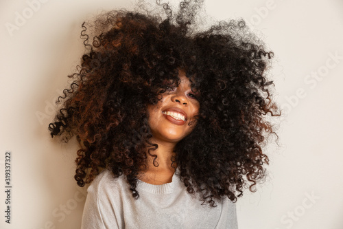 Beauty portrait of african american woman with afro hairstyle and glamour makeup Wallpaper Mural