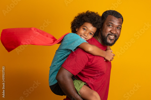 Photo African Father and Son playing Superhero at the day time