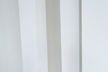 Vertical White Columns Against...
