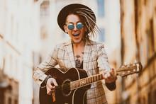 Emotional Singing Guitarist