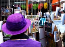 A Woman In A Purple Dress Look...