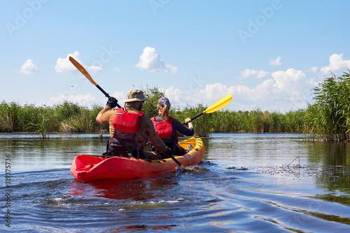 Cuadros en Lienzo Couple kayaking on river together
