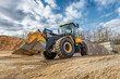 Wheel loader rides on a construction site.