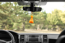 Air Freshener Hanging On Rear View Mirror In Car