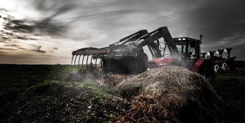 tractor and its telescopic fork handling manure