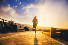 Silhouette Of Man Jogging On W...