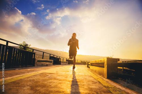 Silhouette of man jogging on walk way Fototapete