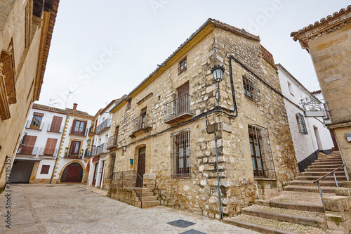 Traditional antique houses and stone street in Baeza, Jaen. Spain