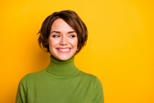 Closeup Photo Of Short Hairdo Pretty Lady Charming Smiling Good Mood Looking Side Empty Space Sly Eyes Wear Casual Green Warm Turtleneck Isolated Yellow Color Background