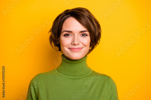 Obraz Closeup photo of funny short hairdo lady charming smiling good mood positive person wear casual green turtleneck warm sweater isolated yellow color background - fototapety do salonu