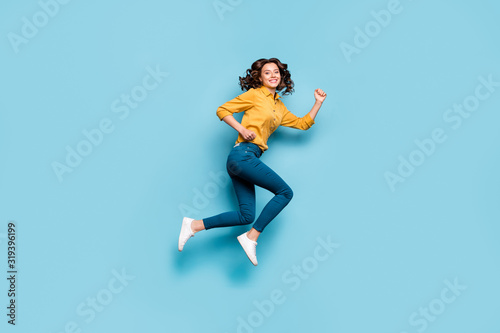Full length body size profile side view of nice sportive cheerful wavy-haired girl jumping running fast life inspiration isolated on bright vivid shine vibrant green blue turquoise color background