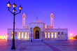 Leinwanddruck Bild - Beautiful architecture of Al Fatch Grand Mosque with lights on early morning over blue sky background, Manama Bahrain