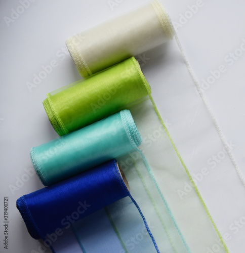 Fotografie, Obraz Reels organza ribbon pastel colors white blue green isolated white background