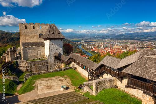 Fototapeta Celje Old castle (Celjski Stari grad), amazing aerial view of medieval fortification and town of Celje in Lasko valley in Julian Alps mountains, Slovenia, Styria. Outdoor travel background obraz