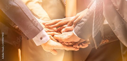 Creative team meeting hands together synergy business man woman, asian people teamwork acquisition, brainstorm business people concept Wallpaper Mural