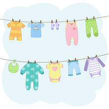 Clean Baby Clothes Hanging On ...