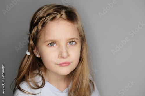 Close-up portrait of beautiful upset little girl Canvas-taulu