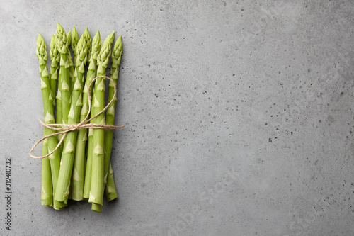 Bunch of green asparagus on concrete background Canvas Print