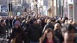 Anonymous / Unrecognisable People walking on Princes Street, Edinburgh. They are shopping and walking. Blurred. Slow motion.