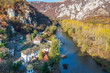 """Beautiful panorama of the Iskar River Gorge in the autumn and the Cherepish Monastery """"God's Mother Assumption"""", Bulgaria. River valley, colorful autumn forest, orthodox monastery and rocky mountain"""