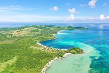 A Tropical Island With A Turqu...