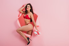 Sexy Girl In Red Lingerie Hold...