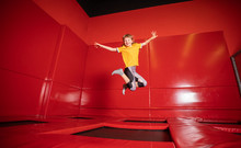 Little Girl Jumping On Trampol...