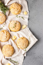 Cheese Scones, Pieces Of Cheese And Thyme On A Grey Napkin. Grey Stone Background, Toned Image.
