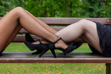Two Women In Black Fishnet Sto...